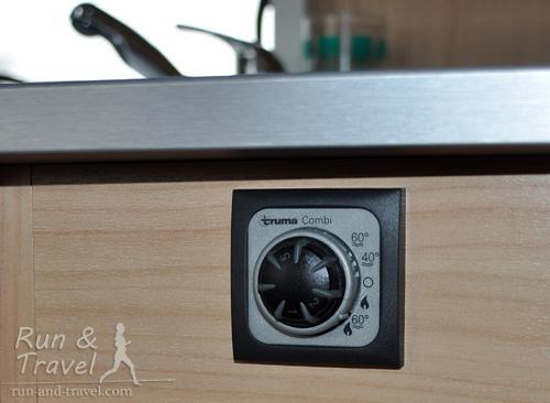 Режим отопления и нагрева воды устанавливается с помощью регулятора